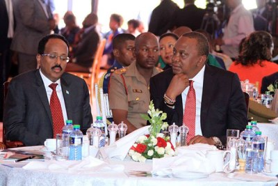 Presidents Mohamed Abdullahi Mohamed Farmaajo of Somalia and Kenya's Uhuru Kenyatta at the national prayer breakfast held at Safari Park Hotel in Nairobi on May 31, 2018.