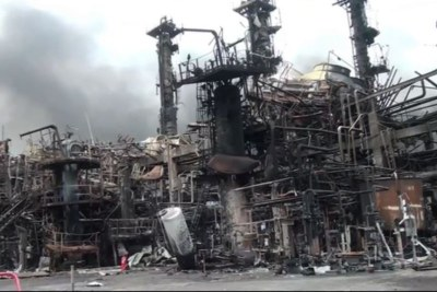 The remains of a Cameroon refinery in Limbe are seen after an explosion shook the facility over the weekend, June 2, 2019.