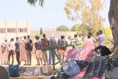 The scene near the detention centre in Tripoli.