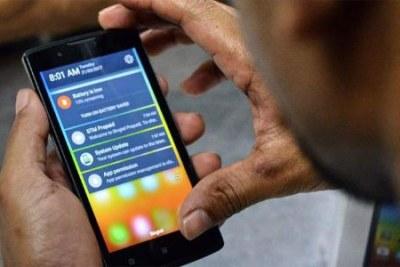 A Safaricom user (file photo).