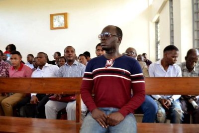 Erick Kabendera in court where he was charged with leading organized crime, failure to pay tax and money laundering (file photo).