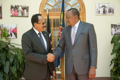 Kenya's President Uhuru Kenyatta (right) welcomes his Somalia counterpart Mohamed Abdullahi Mohamed at State House in March 2017.