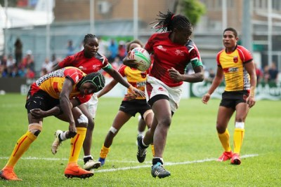 Kenya's Sheilla Chajira cuts through the Papua New Guinea defence on day one of the World Rugby Women's Sevens Series Qualifier in Hong Kong on April 4, 2019.