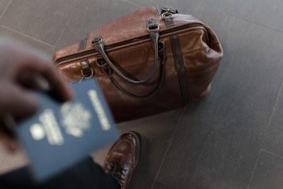 Travel man passport leather bag airport tourist tourism