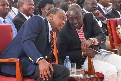 President Uhuru Kenyatta (left) chats with his deputy, William Ruto (file photo).