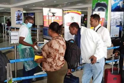 Travellers undergo security checks and coronavirus screening on arrival at Entebbe International Airport on February 6, 2020.