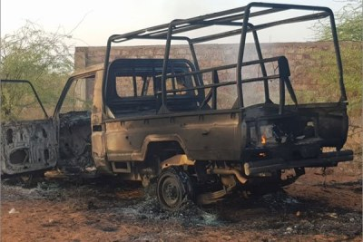 The shell of a vehicle burnt during a clash between two Somalia forces on March 2.
