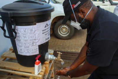 Healthcare worker washing his hands at an MSF HIV testing Site in Nhlangano.