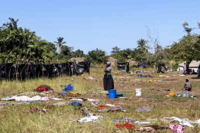 A woman stands in field where clothes are dried after washing in Metuge, Cabo Delgado Province. Make shift displace person camps have formed after a series of attacks has forced thousands to flee the north region.