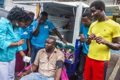 Blood pressure screening in Freetown, Sierra Leone.