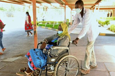 Susan Liaman is wheeled out of hospital after failing to get medical services at Nakuru Level Five Hospital on December 21, 2020.
