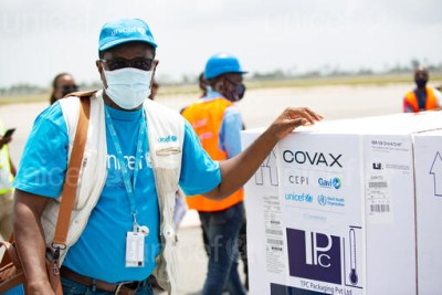 UNICEF supply officer Mohamadou Sy at the airport in Abidjan where a shipment of COVAX COVID-19 vaccines are offloaded.