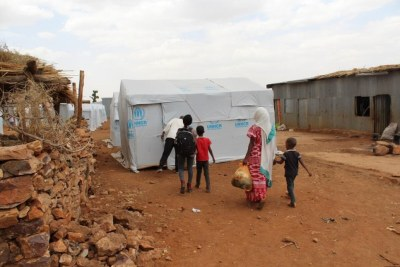 Eritrean refugees arrive in Adi Harush camp, after being relocated from other camps in the north of Ethiopia's Tigray region that were destroyed in the early months of the conflict.